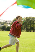 Boy flying a kite — Stock Photo