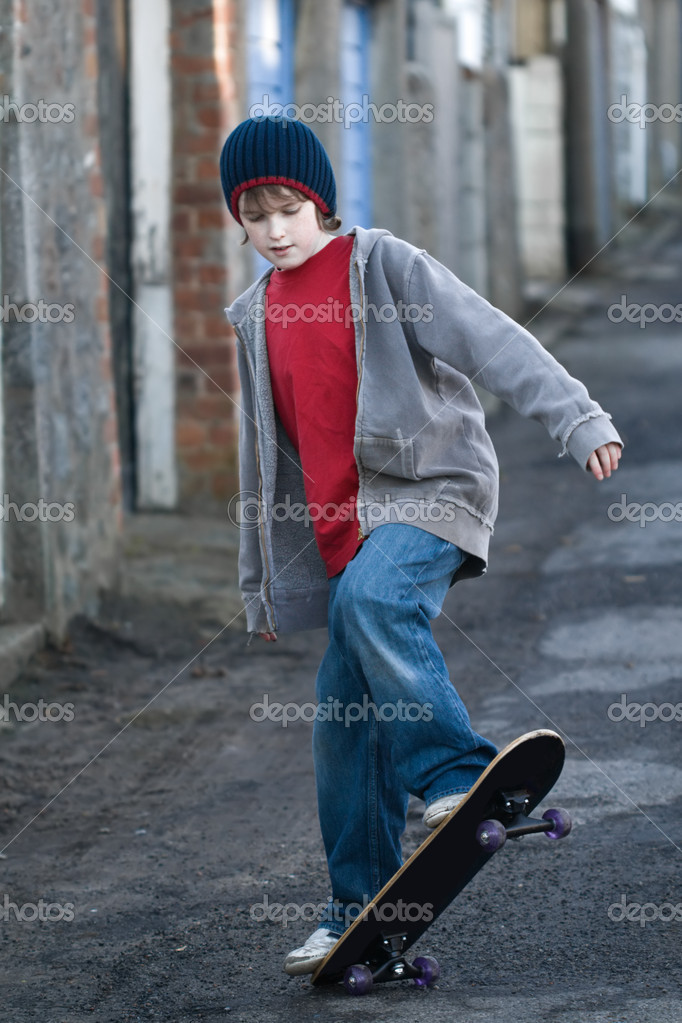 Boy skateboarding in an alleyway  Stock Photo #2269750