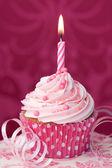 Pink birthday cupcake — Stock Photo