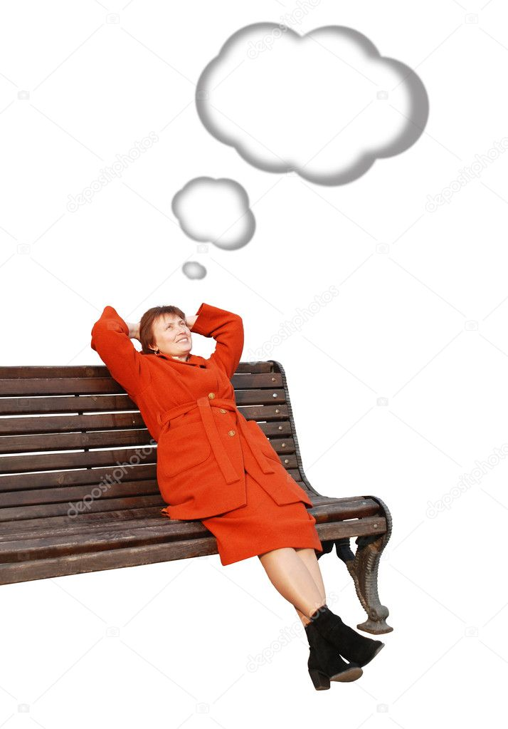 Women in orage coat sitting on bench and dreaming — Stock Photo #2082837
