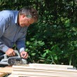 Stock Photo: Carpenter at work