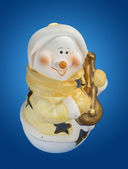 Snowman with lute — Stock Photo