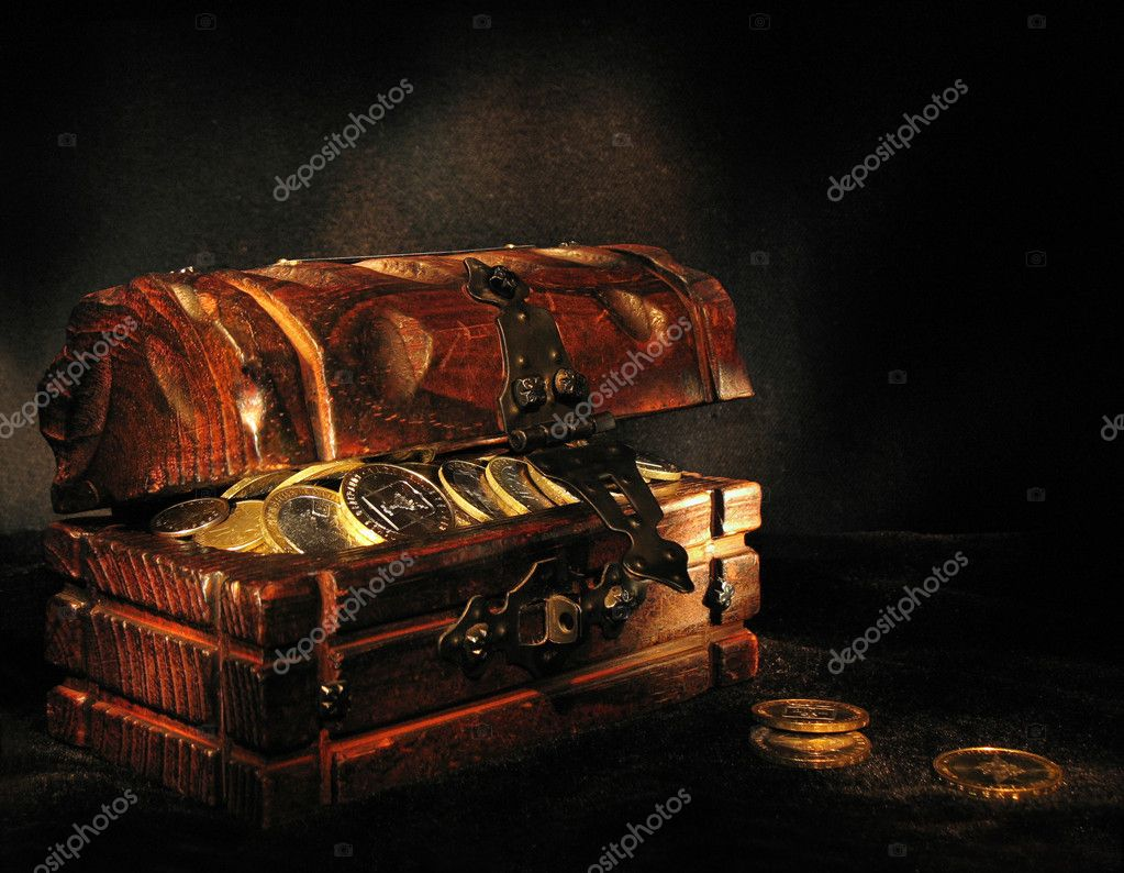 Wooden chest with coins on a dark background — Stock Photo #2397828