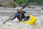 Kayaker fighting the rapids of a river. — Foto de Stock