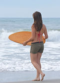 Athletic teen girl at the beach. — Stock Photo