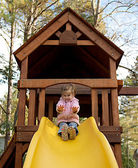 Toddler sliding down a sliding board. — Stock Photo