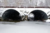 Snow covered drainage tunnel. — Stock Photo