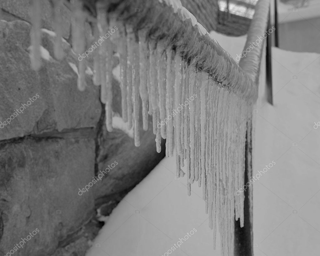 Selective focus image of a dangerous stairway with an ice covered banister. — Stock Photo #2091924