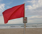 Red Warning Flag on the Beach — Stock Photo