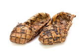 Russian bast shoes on a white background — Stock Photo