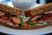 Salmon sandwich close-up, shallow DOF — Stock Photo