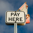 Royalty-Free Stock Photo: PAY HERE sign