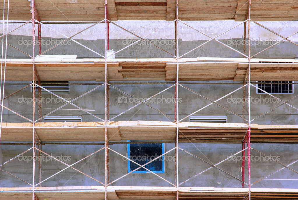 Metal rail and wooden toe-board scaffolds on a building, close-up  Stock Photo #2155326