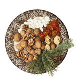 Old plate with nuts, seeds, dried fruits — Stock Photo