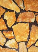 Stone yellow wall — Stock Photo