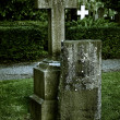 An old cross at a cemetary - Stock Photo