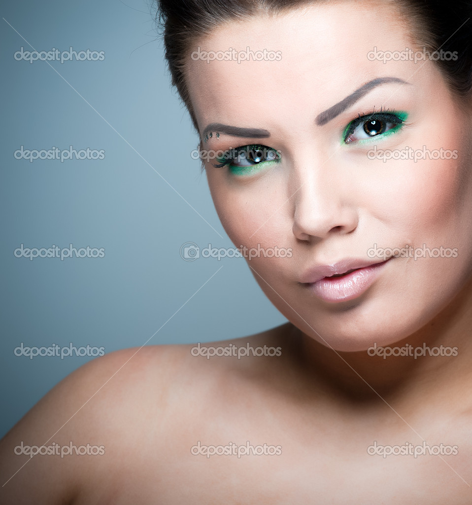 Young brunette wearing colorful green make up  Stock Photo #2127488