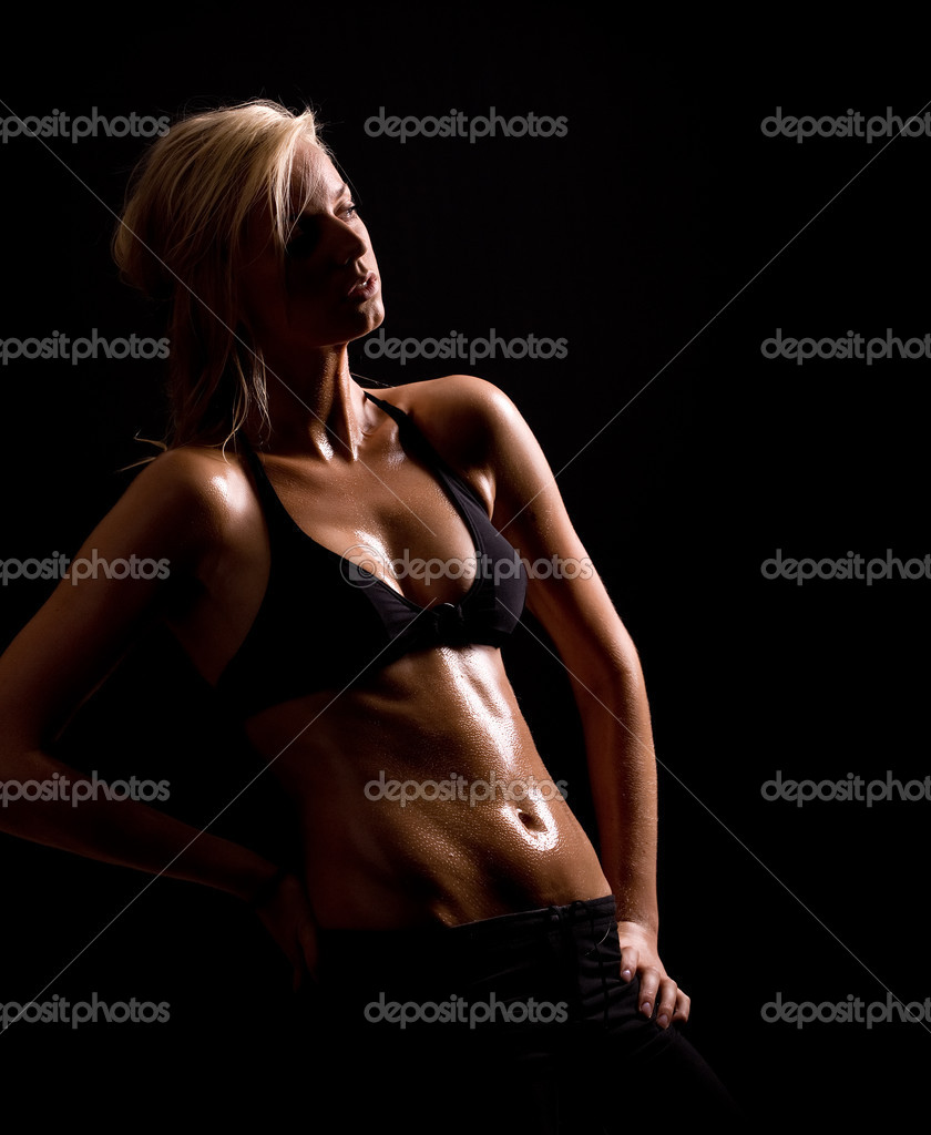 A blond beauty in bikini top sweaty after working out  Stock Photo #2222426