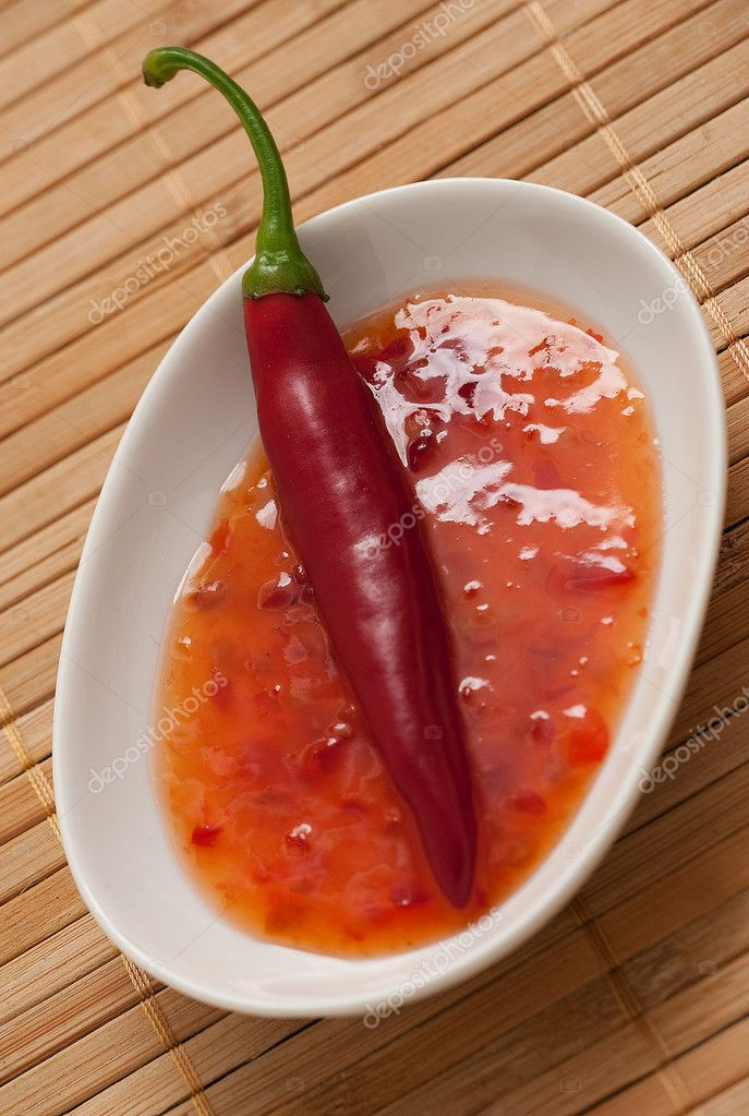 A red chili fruit in a hot sweet and sour sauce  Stock Photo #2228907