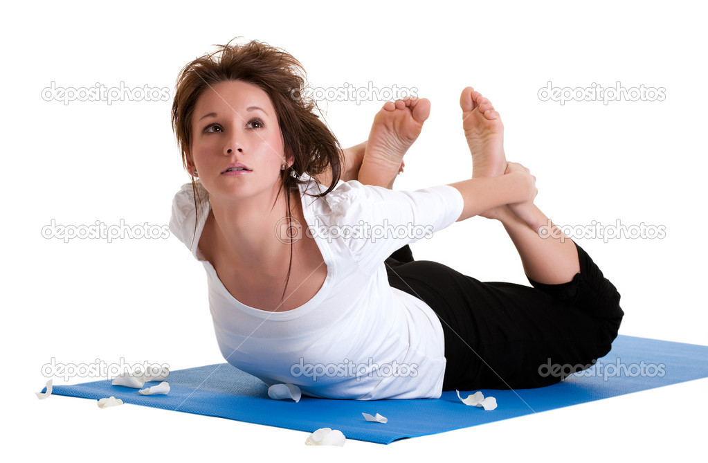 A young healthy girl exercising with yoga — Stok fotoğraf #2231009