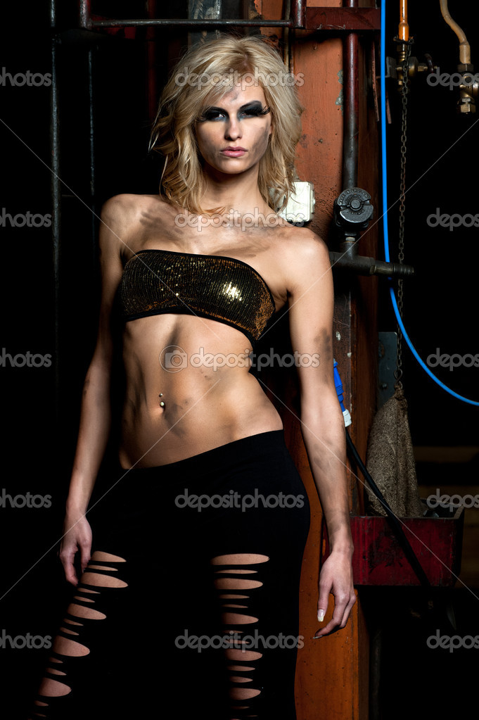 A fashion model posing in a dirty storage room — Foto Stock #2436434