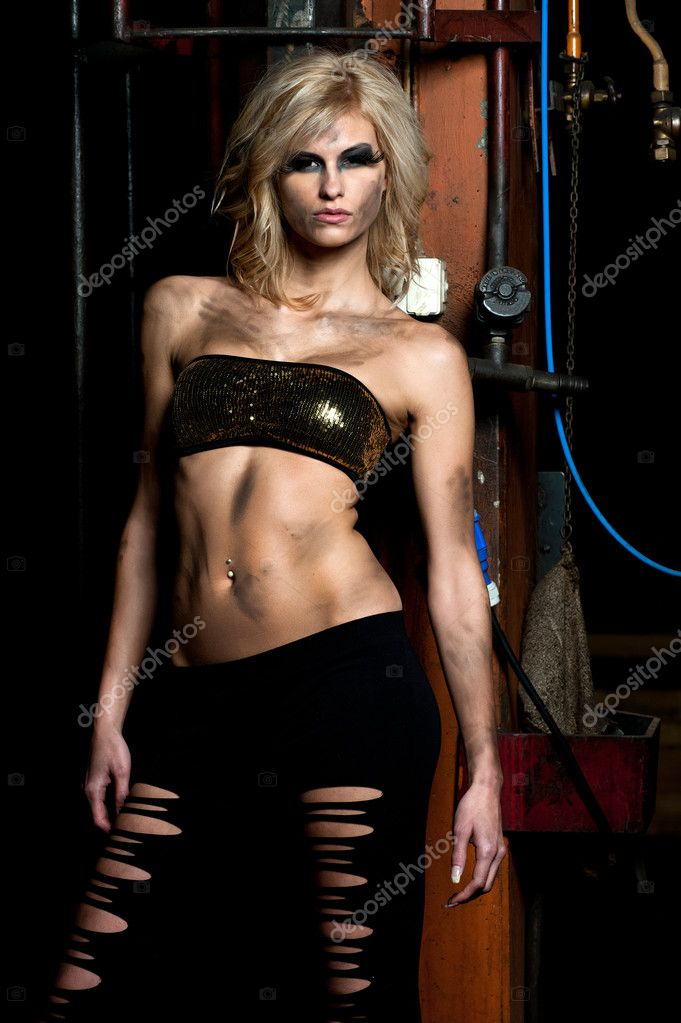 A fashion model posing in a dirty storage room — Stock Photo #2436434