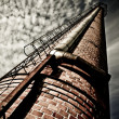 Old factory chimney - Stock Photo