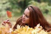Girl with a maple leaf — Stock Photo