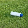 Stock Photo: Bottle of water on green grass