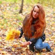 Stock Photo: Long-haired girl in autumn wood