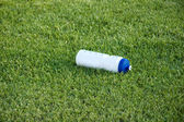 Bottle of water on the green grass — Stock Photo