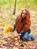 Long-haired girl in autumn wood — Stock Photo