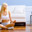 Young Woman Sitting on Wood Floor Meditating — Stock Photo