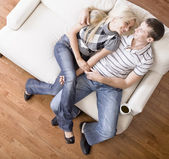 Young Couple Sitting on Love Seat — Stockfoto