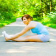 Young Woman Outdoor Workout - Stock Photo