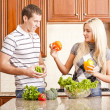 Stock Photo: Young Couple Making Salad