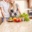 Young Couple Posing in Kitchen — Stock Photo