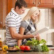 Young Couple Cooking — Stock Photo #2627542