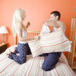 Young Couple Kneeling on Bed Having a Pillow Fig — Foto de Stock
