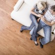 Young Couple Sitting on Love Seat — Stock Photo #2627699