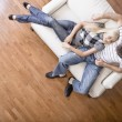 Young Couple Sitting on Love Seat - Photo