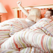 Young Couple Waking Up in Bed — Stock Photo