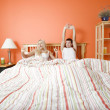 Young Couple Lying in Bed Stretching — Stock Photo