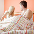 Stock Photo: Young Couple Sitting Up in Bed