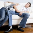 Couple Relaxing on Couch - Stock Photo