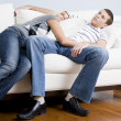 Couple Relaxing on Couch — Stock Photo #2627813