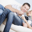 Affectionate Couple Laughing and Relaxing on Cou — Stock Photo #2627983