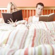 Couple Reading in Bed — Stock Photo #2628028