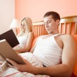 Couple Reading in Bed — Stock Photo
