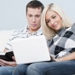 Couple Relaxing on Couch — Stock Photo